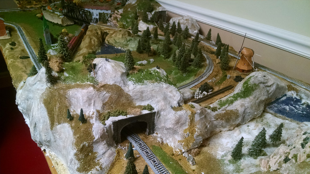 model train winter mountains