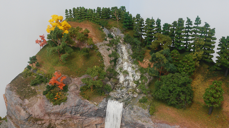 model train layout rock face waterfall