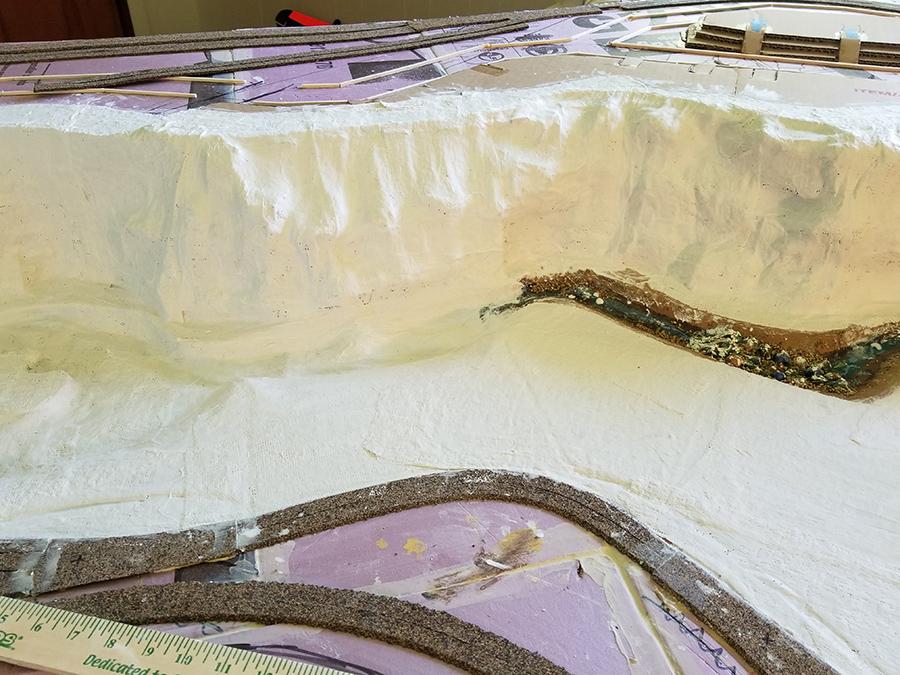model train rock face