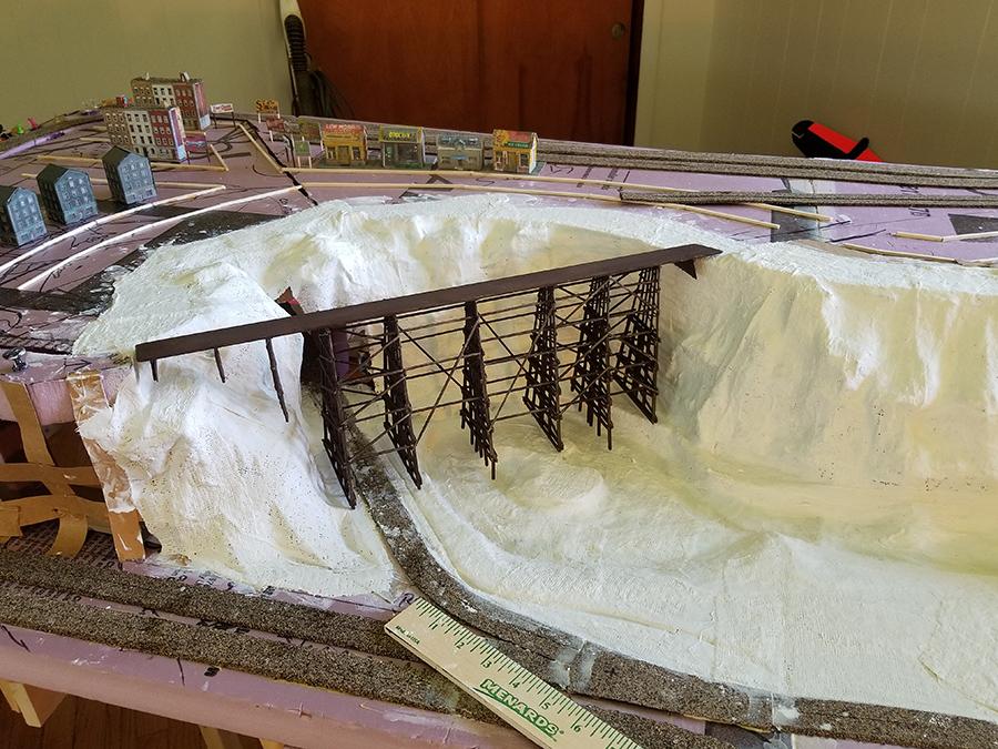 Model train bridge rockface