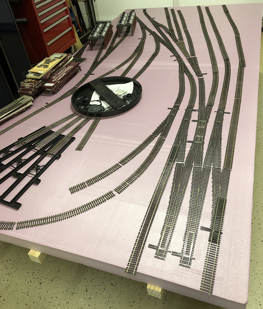 model railroad laying the track