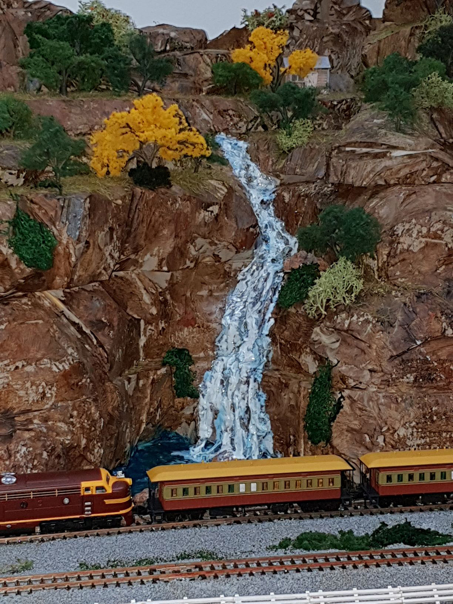 model railroad mountain side stream
